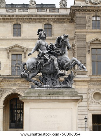 Equestrian statue of king Louis XIV in the courtyard of the Louvre museum. Made by Gian Lorenzo Bernini (1598-1680) - stock photo