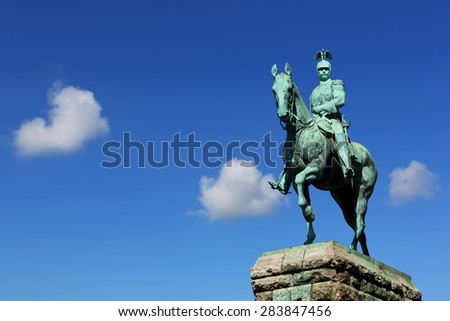 Equestrian statue of the member of Hohenzollern dynasty with beautiful blue sky background  in Cologne, Germany - stock photo