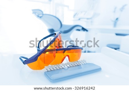 Equipment and dental instruments in dentist's office. Googles, tools close-up. Dentistry - stock photo