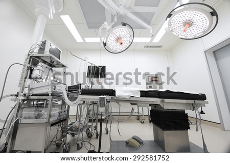 equipment and medical devices in modern operating room take with selective color technique and art lighting - stock photo