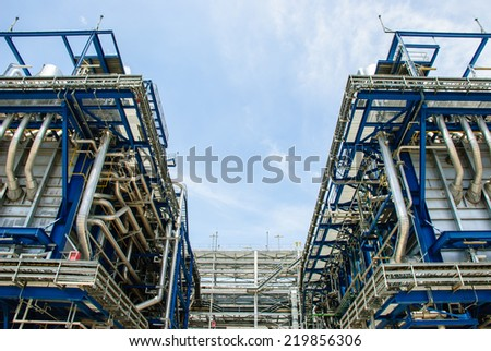 Equipment and piping as found outside of a modern industrial power plant, Ratchaburi, Thailand. - stock photo