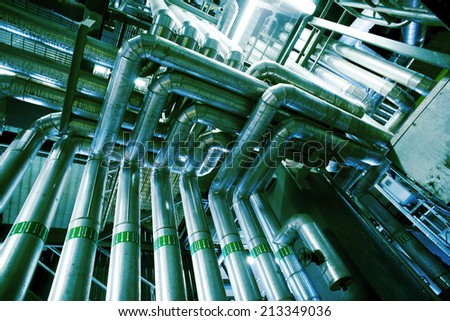 Equipment, cables and piping as found inside of a modern industrial power plant - stock photo