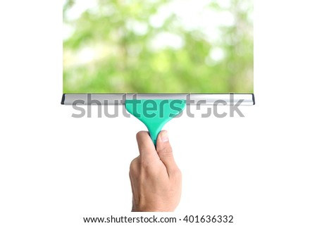 Equipment for cleaning glass in hand isolated on white background. - stock photo