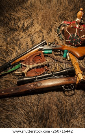 Equipment for hunting on wild boar skin - stock photo