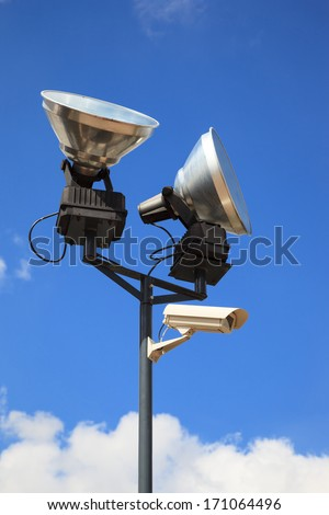 Equipment for safety oversight - camera and lamp. - stock photo