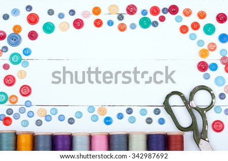 Equipment for sewing. Accessories for handmade sewing on white wooden background with copy space. Spool of thread, scissors, buttons. Set for needlework top view. Retro style - stock photo