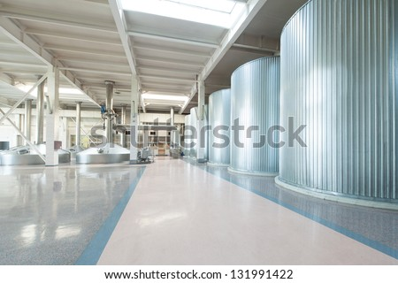 Equipment for the brewery. Large shiny tanks. - stock photo