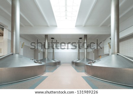 Equipment for the brewery. Shiny tanks in white room, view down. - stock photo