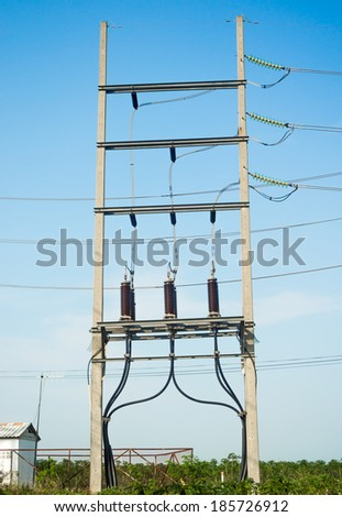 Equipment of high-voltage  3-phase substation - stock photo