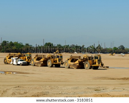 Equipment Parked at a Construction Site - stock photo