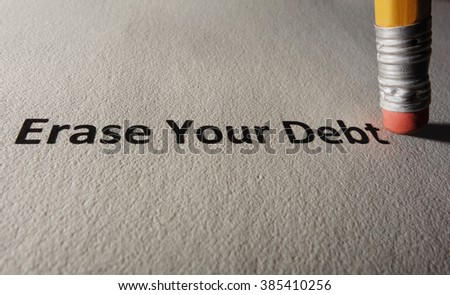 Erase Your Debt text on paper with pencil eraser                                - stock photo