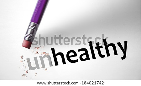 Eraser changing the word Unhealthy for Healthy  - stock photo