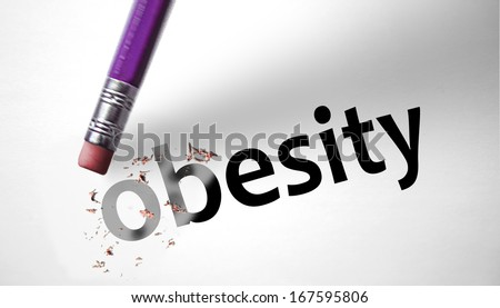 Eraser deleting the word Obesity - stock photo
