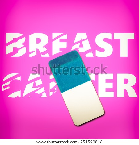 Eraser erasing the words BREAST CANCER on a pink background - stock photo