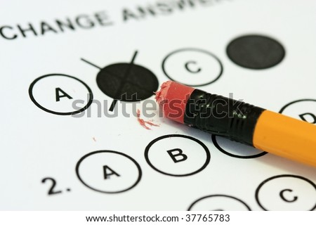 Erasing an answer on a multiple choice exam sheet - stock photo