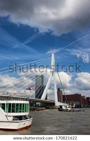 Erasmus Bridge (Dutch: Erasmusbrug) in the city downtown of Rotterdam, South Holland, the Netherlands. - stock photo