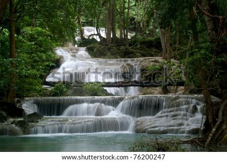 Erawan waterfall in the forest at Kanchanaburi city , THAILAND. - stock photo