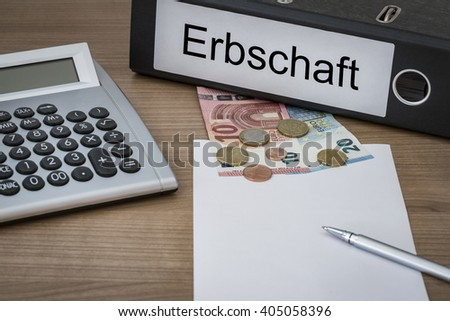 Erbschaft (German inheritance) written on a binder on a desk with euro money calculator blank sheet and pen
