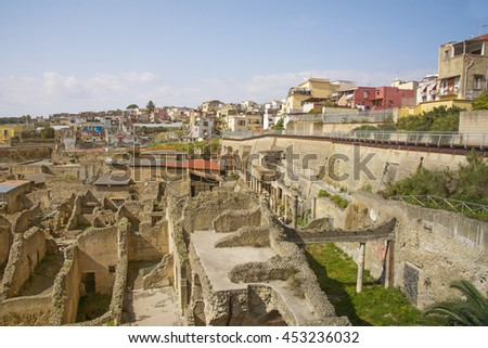 "ERCOLANO,ITALY-MARCH 26, 2016:Herculaneum archeological site hentrance and view of the ""new"" town on background."