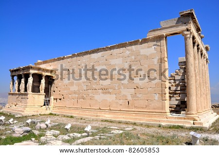 Erechtheion on blue sky background - part of Acropolis in Athens. Full view. - stock photo