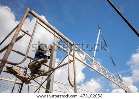 Erection roof truss work with blue sky background.