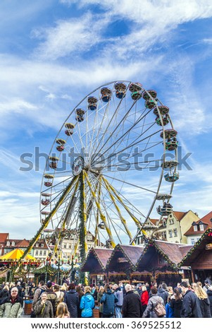 ERFURT, GERMANY - DEC 20, 2015: people visit big wheel at christkindl market in Erfurt, Germany. This market is one of the loveliest in whole Germany and is the largest in Thuringia.