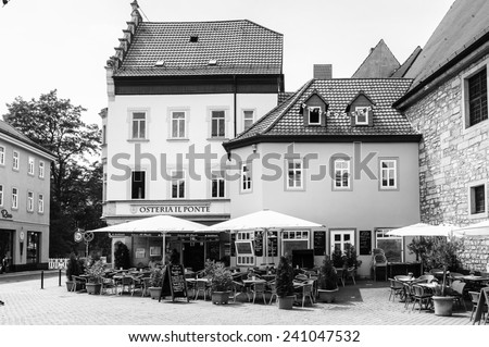 ERFURT, GERMANY  - JUN 16, 2014: Architecture and restaurants at the Wenigenmarkt Square of the city of Erfurt, Germany. Erfurt is the Capital of Thuringia and the city was first mentioned in 742