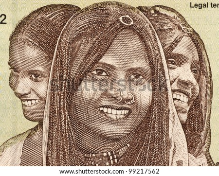 ERITREA - CIRCA 1997: Three Young Women on 10 Nakfa 1997 Banknote from Eritrea.