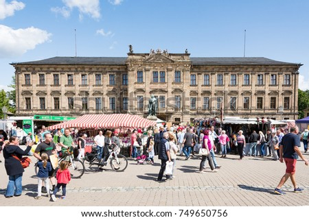ERLANGEN, GERMANY - AUGUST 20: People at a market in front of Schloss Erlangen, Germany on August 20, 2017.  The castle was built in the year 1700.