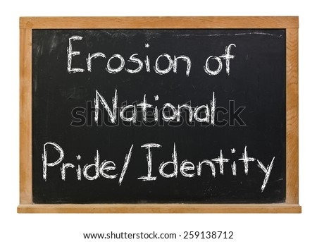 Erosion of national pride and identity written in white chalk on a black chalkboard isolated on white - stock photo