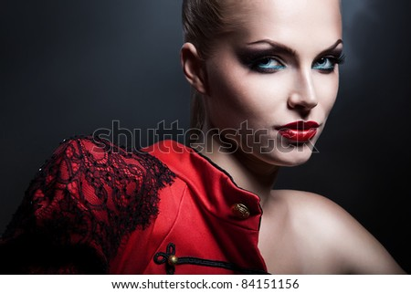 erotic blonde sexy woman in red jacket with red lips - stock photo
