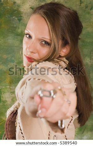 Erotic brunette girl with chain on green backgrounds