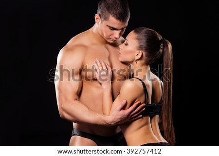 Erotic fitness couple. Sensual hugs of fitness couple. In search of tranquility. Sweetest moments of life.