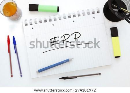 ERP - Enterprise Resource Planning - handwritten text in a notebook on a desk - 3d render illustration. - stock photo