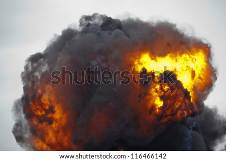 Erupting ball of flame and smoke from explosion - stock photo