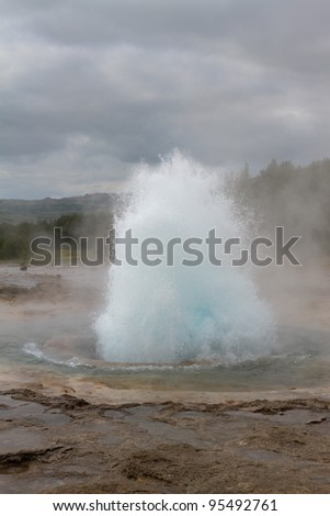 Erupting geyser; Strokkur on Iceland - stock photo