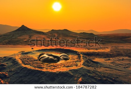 Erupting mud volcanoes in Buzau, Romania at sunrise. Dramatic landscape. - stock photo