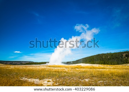 Erupting Old Faithful Geyser Old Faithful Geyser, Yellowstone National Park, Jackson Hole, Wyoming USA - stock photo