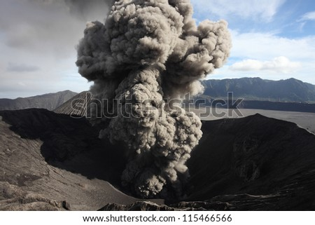 Eruption of ash cloud from crater of Mount Bromo, Tengger Caldera, Java, Indonesia - stock photo
