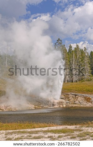 Eruption of the Riverside Geyser in Yellowstone National Park - stock photo