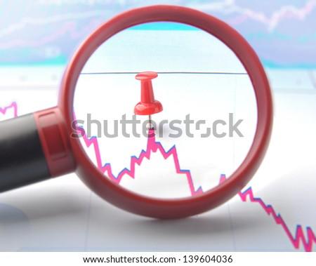 erve curve chart through magnifier - stock photo