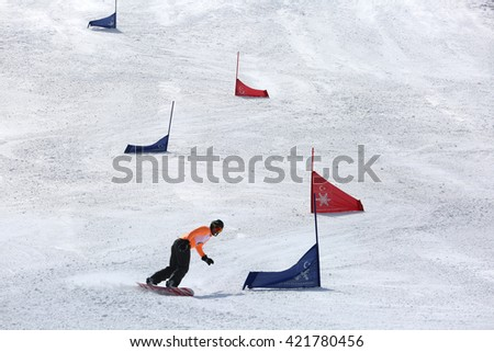 Erzurum, Turkey - March 25, 2016 : Snowboarder rides the slope during the Unilig University winter competitions on March 25, 2016 in Erzurum, Turkey.""