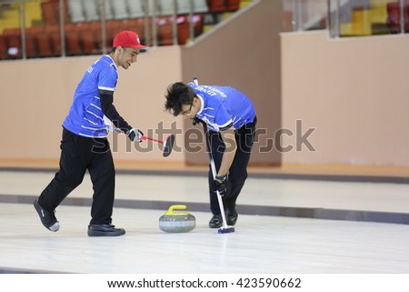 Erzurum, Turkey - March 24, 2016 : University students are playing curling during the Unilig University winter competitions March 24, 2016 in Erzurum, Turkey.