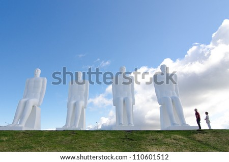 ESBJERG - AUGUST 6: The Men at Sea is a monument of four 9 meter tall white males, located in Esbjerg, Denmark on the Beach on August 6, 2012. The sculpture was designed by Svend Wiig Hansen. - stock photo