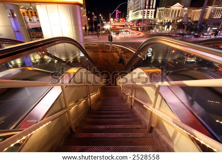 Escalator and Staircase Down with Blurred Traffic and Lights - stock photo