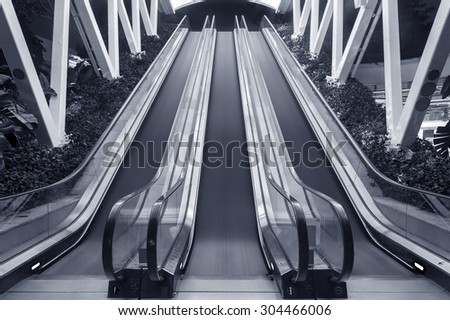 escalator and stairway of contemporary building - stock photo