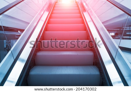 Escalator blue color tone. - stock photo