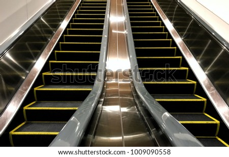 Moving Up Staircase. Escalator. Electric Escalator.