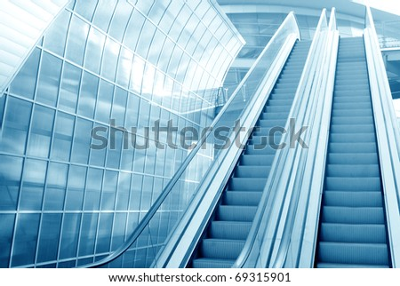 Escalator in business center move up - stock photo
