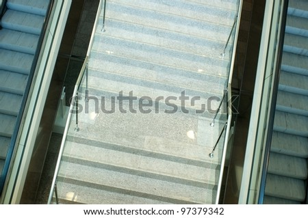 Escalator in modern building. - stock photo